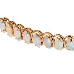 Прелестный золотой браслет с опалами